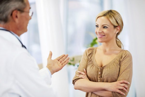 Woman speaking with plastic surgeon