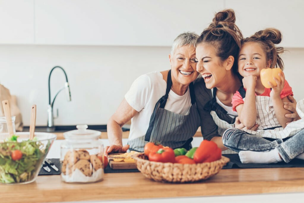 Happy Mother, Daughter, and Grandmother Family Enjoying Healthy Foods in Every Stage of Life